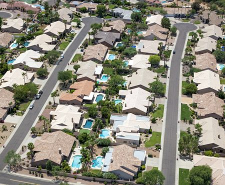 aerial view of multiple homes showcasing their roofs