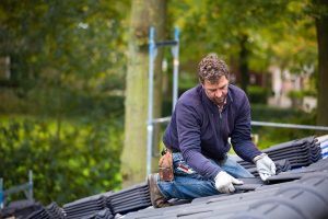 Roofer installing a title 24 roof