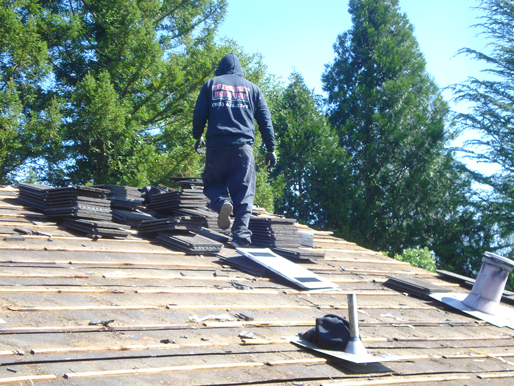 Roofing in Livermore worker on the job