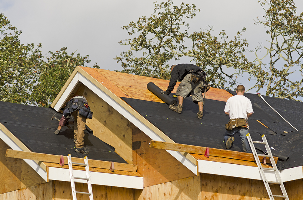 roofers at work on new installation